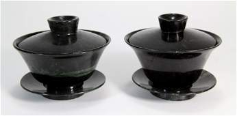 139: Pair of Chinese Spinach Jade Tea Cups w/ Saucers