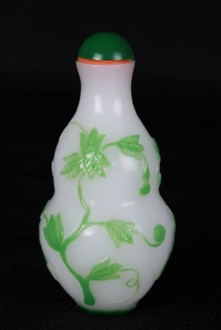 Chinese Green Overlay Milk White Snuff Bottle
