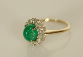 An Emerald Cobochon Ring W/ Diamond