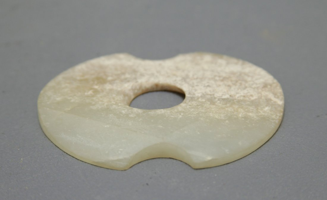An Early White Jade Bi Disc