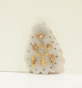 A Jadeite Pendant Inlaid Gold
