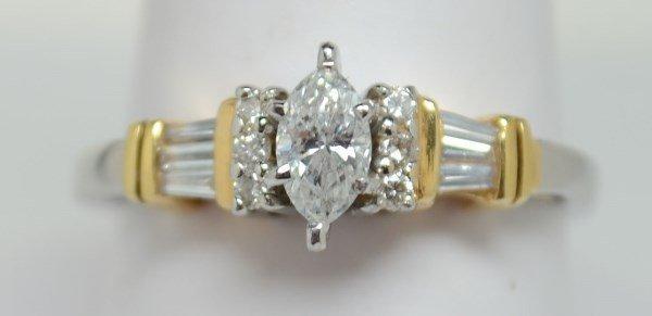 Gorgeous two-toned diamond ring..35ct. Size 8.5.
