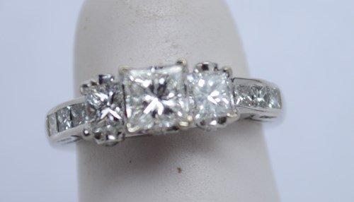 14kt 3 Stone Princess Cut Diamond Ring. Size 4. 1.25