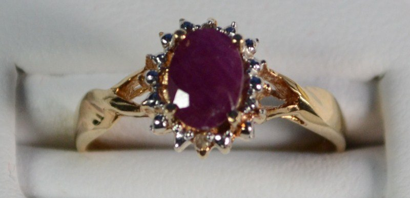 10 K YELLOW GOLD LAB CREATED RUBY AND DIAMOND RING.