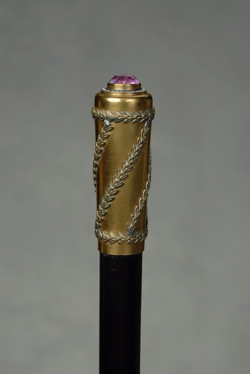 21: A gold and vermeil silver cane with a pink topaz