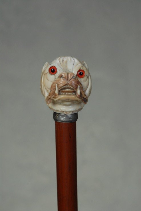 22: A great ivory English bulldog cane
