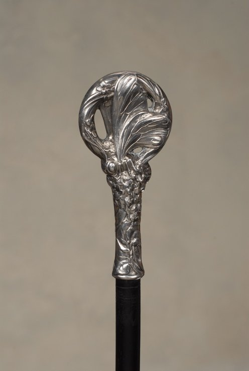 13: A lovely French Art Nouveau silver cane of a butter