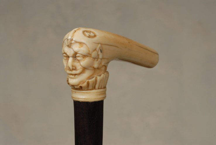 31: A very nice ivory devil's head cane