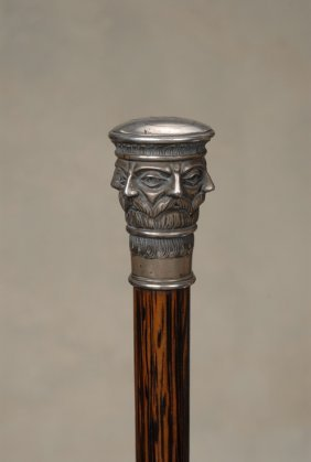 A Norwegian Silver Cane Of A Repeated Facial Image
