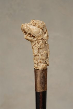 A Great Ivory Cane Of A Stylized Dog With Hunters