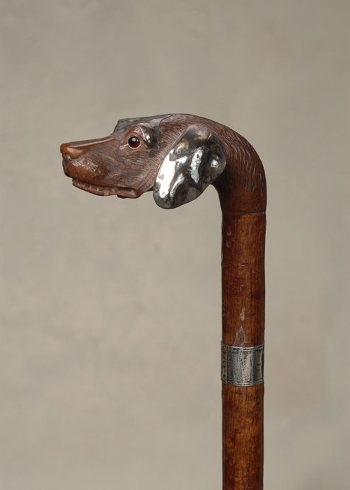 57: A very nice carved wood hound with silver accents