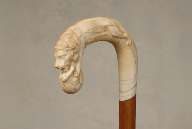 66: A great ivory cane of a male lion