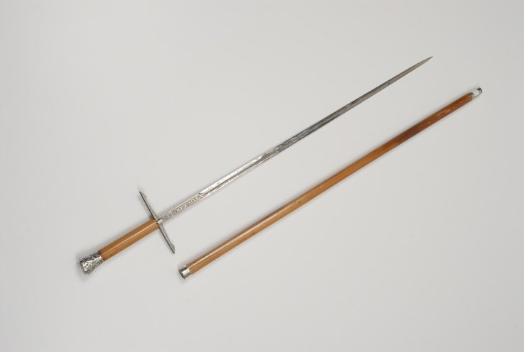 90: A silver and malacca sword cane curio with quillons