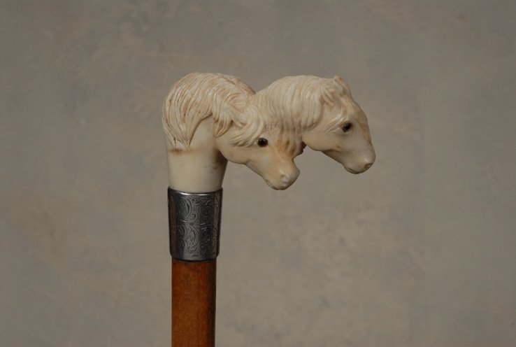 96: A great ivory cane of two horses