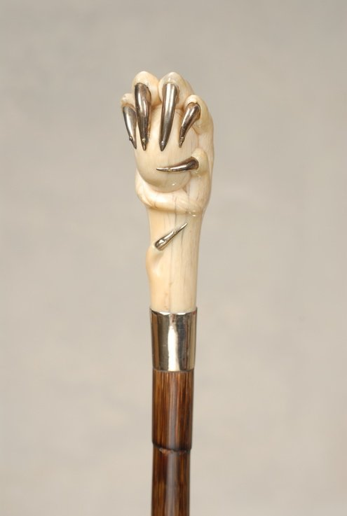 9: A fine ivory egg and claw cane