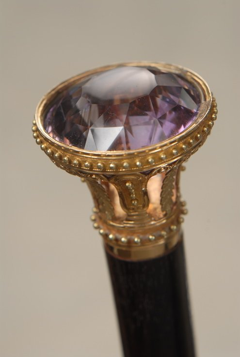 10: A beautiful gold cane with a large inset amethyst