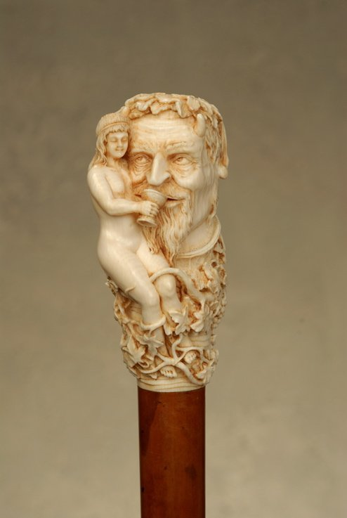 A superb ivory cane of Bacchus and a maiden