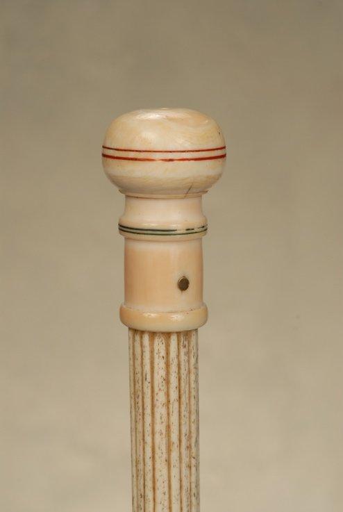 A great ivory knob nautical cane with fluted whalebone