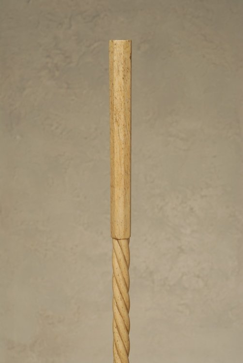 A carved whalebone cane with an inlaid compass rose