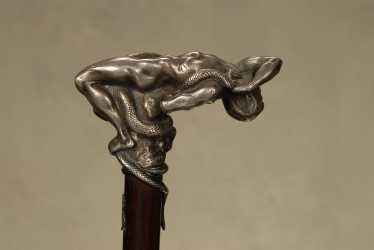 A fine silvered bronze cane of a boy and snake