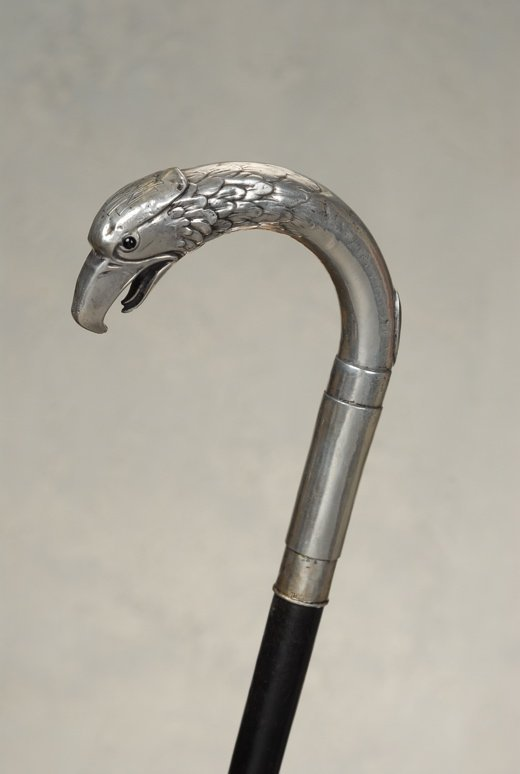 A silver crook cane of an eagle