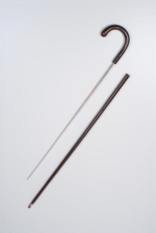 A gutta percha veneer sword cane curio
