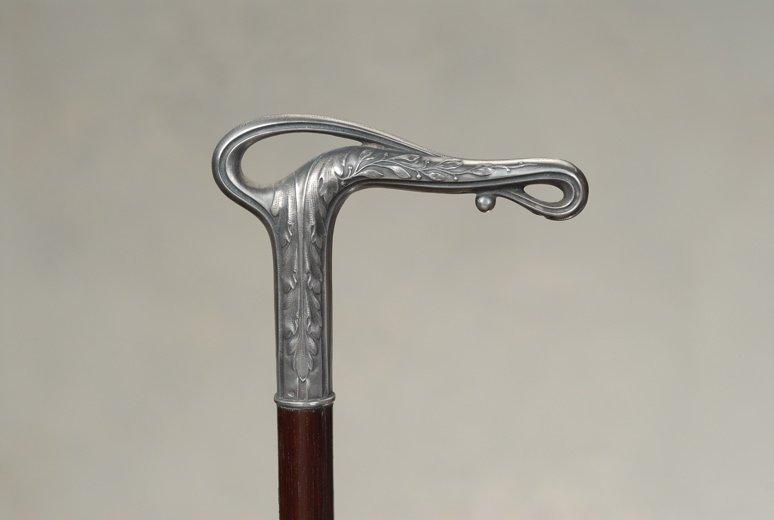 A very fine Art Nouveau silver cane on snakewood
