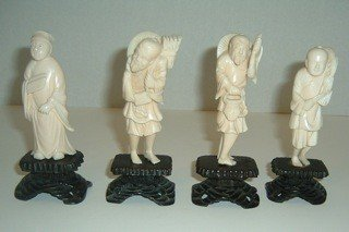 8: Four Carved Ivory Figures