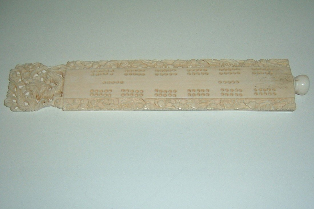 10: Carved Ivory Cribbage Board