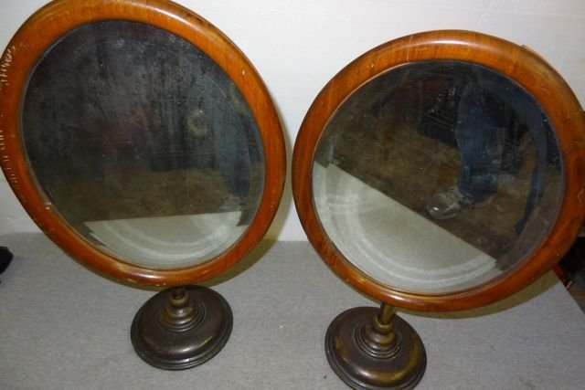 23: 2 Early Oval Adjustable Brass & Wood Store Mirrors