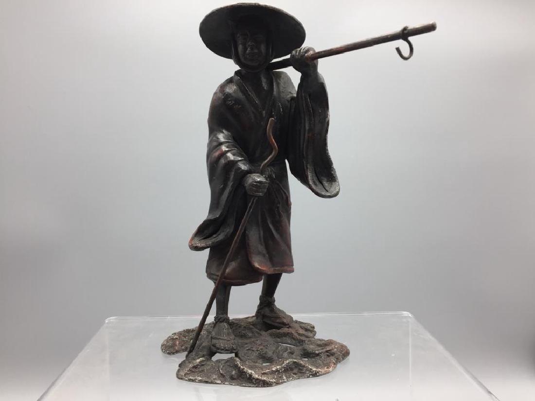 Bronze figure of Asian man