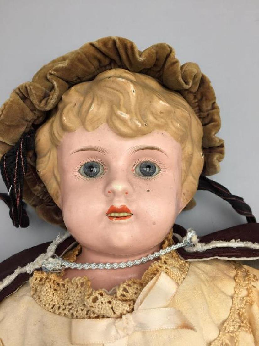 Early made in Germany tin Head doll - 2