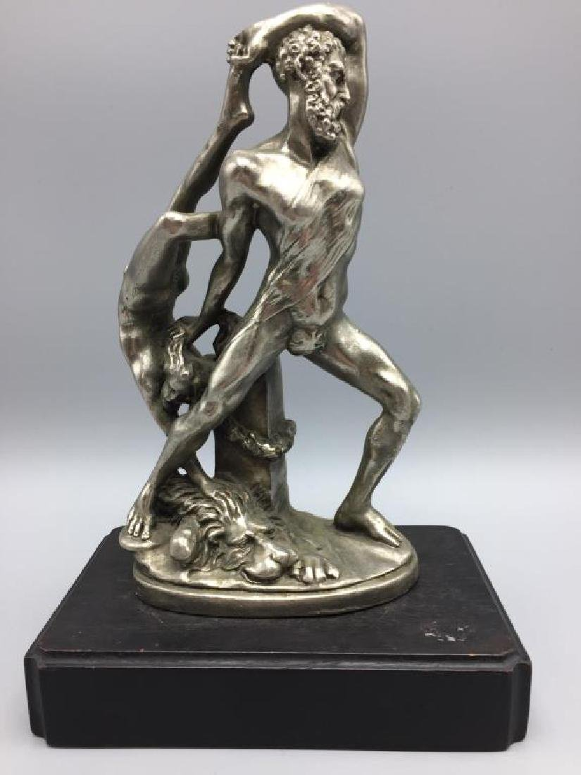 Sculpture of nude man and woman