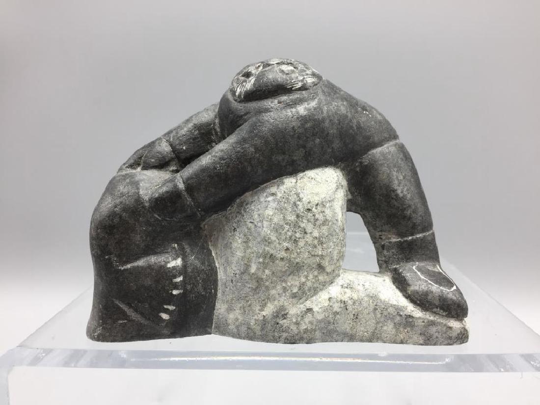 Inuit eskimo fighting a walrus statue