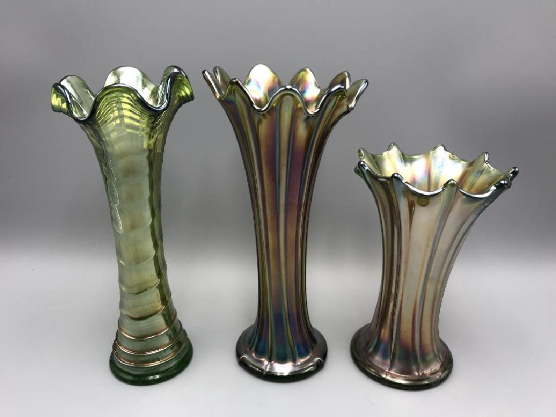 Lot of three carnival glass vases