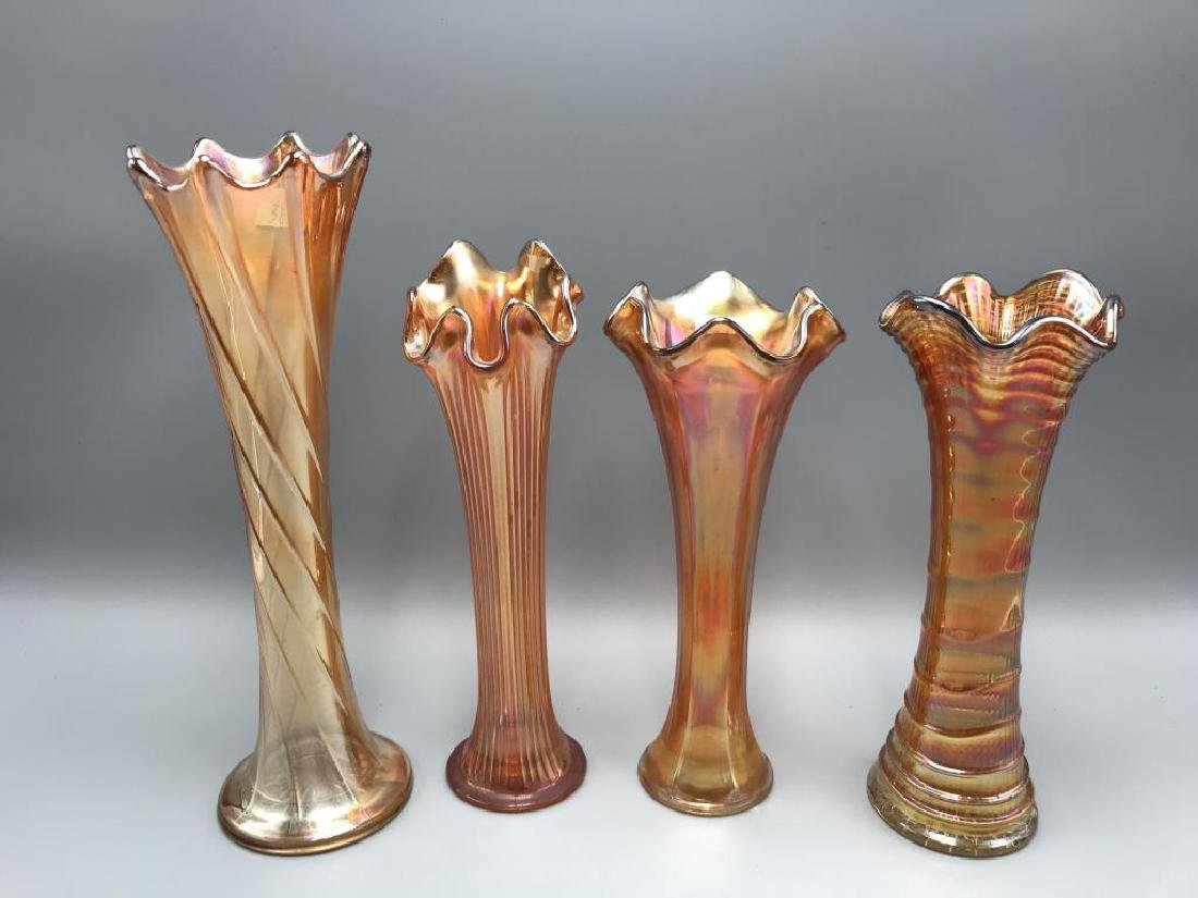 Lot of four marigold carnival vases