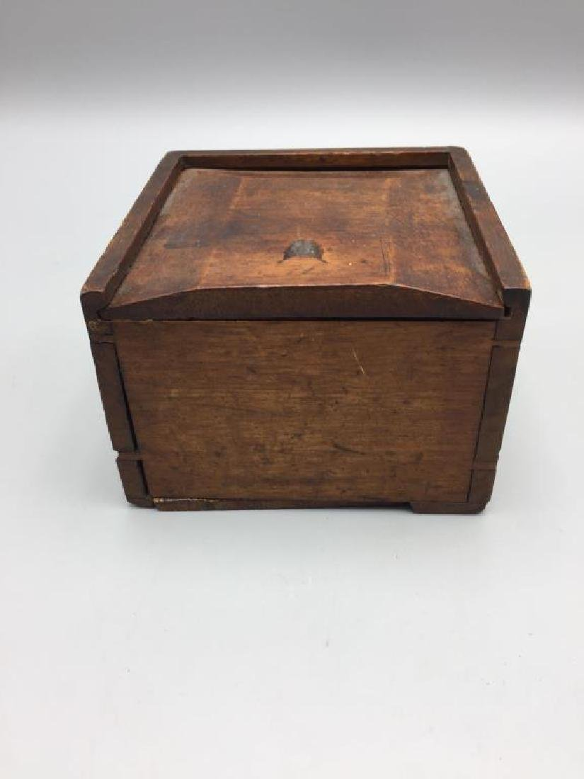 Early ship compass in wooden box
