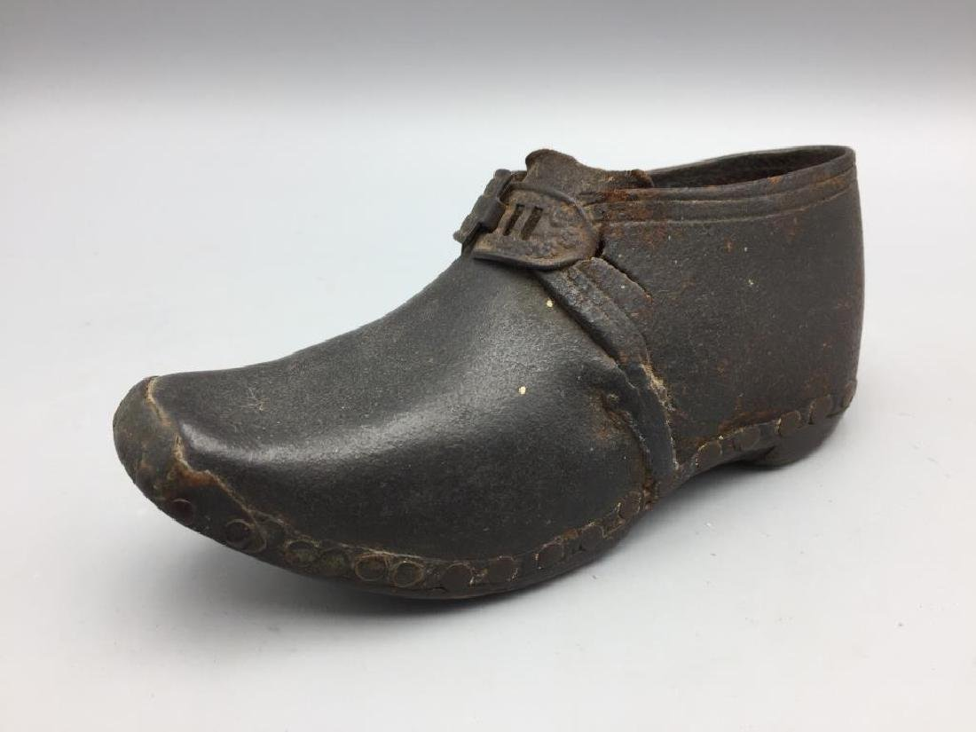 Early wooden and leather child shoe;