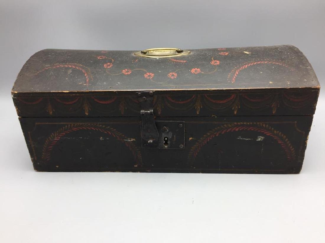 Early wooden dome box with wallpaper interior