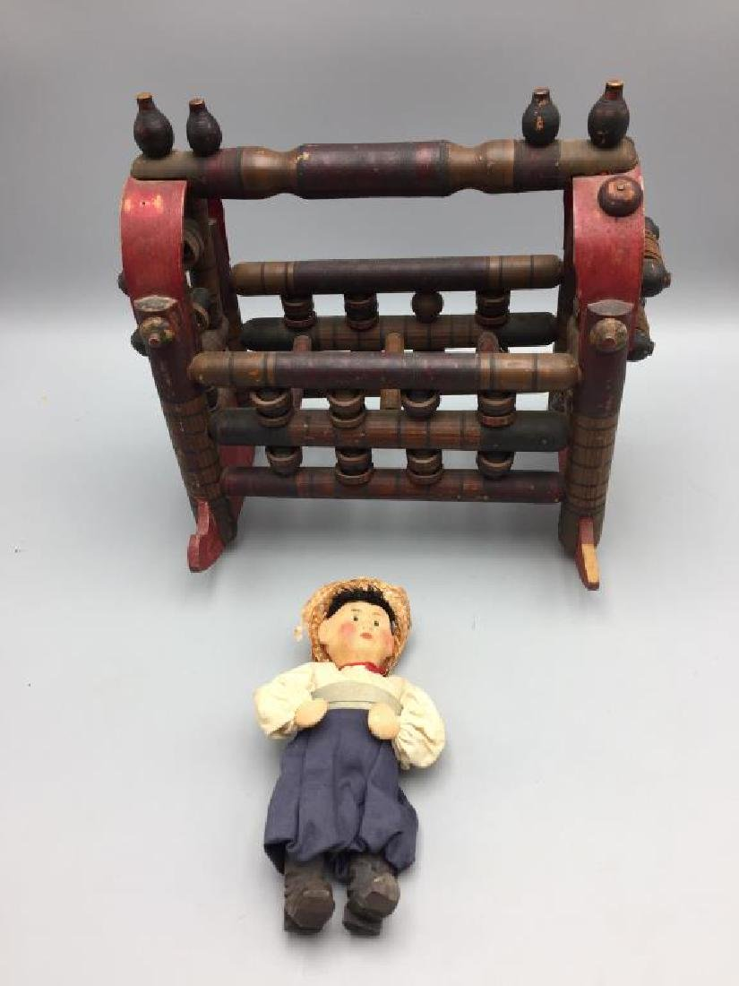 Tramp Art Russian wooden cradle with doll;