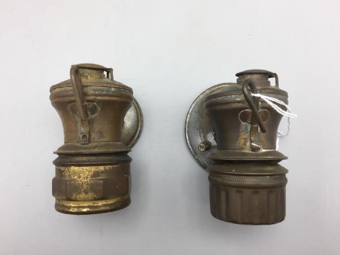 2 antique automobile lanterns