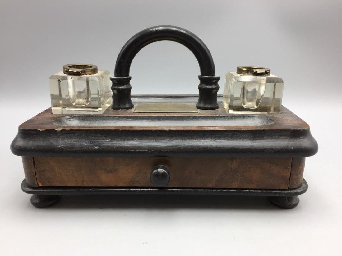 Wooden desk set with inkwells