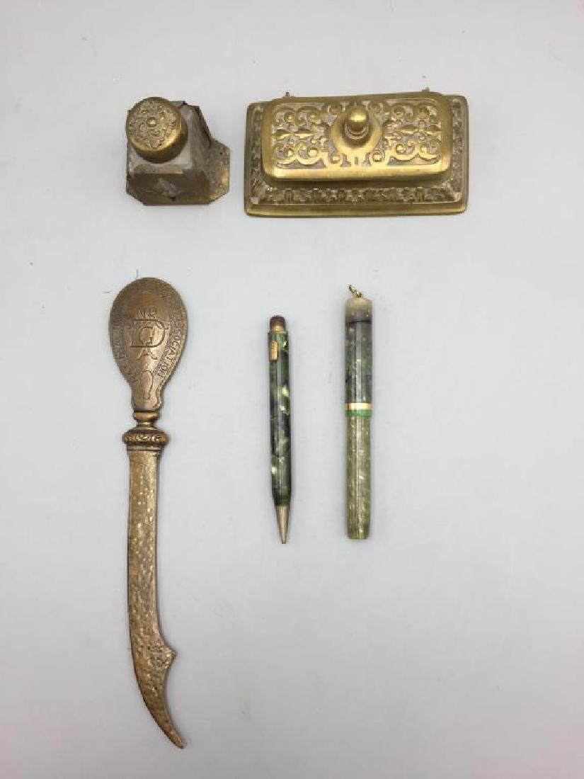 Brass desk set with letter opener pens and inkwell