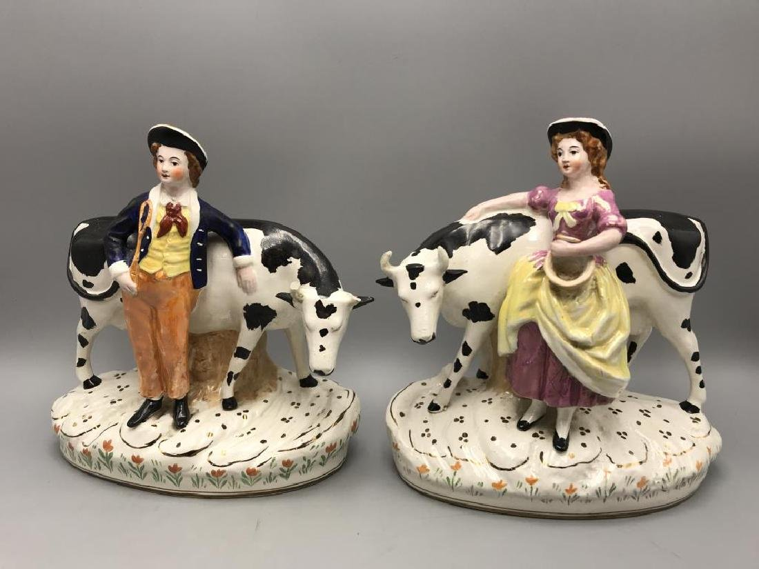 Staffordshire boy and girl with cow statues