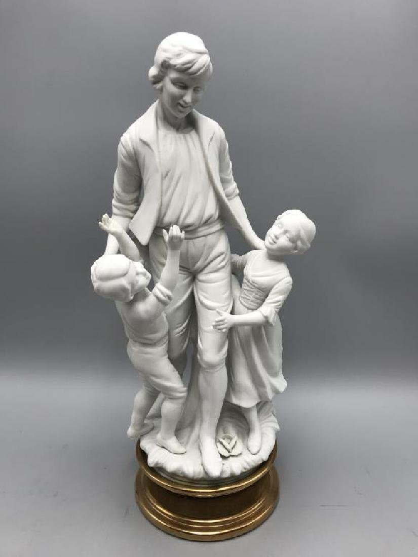 Parian statue of father and children