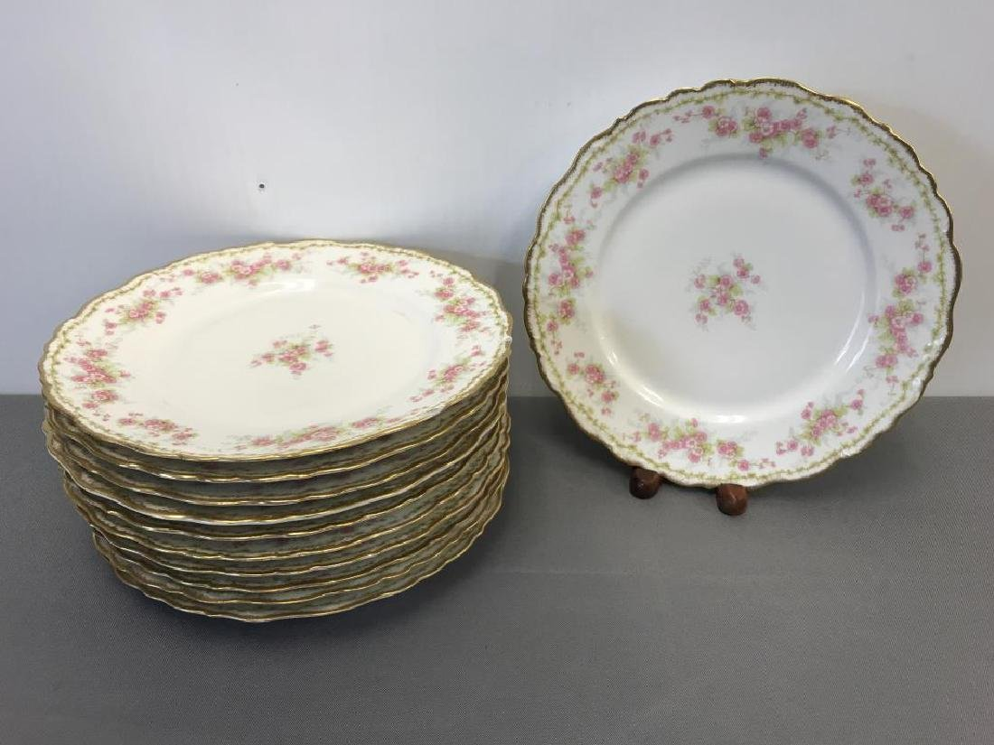 12 Limoge dinner plates