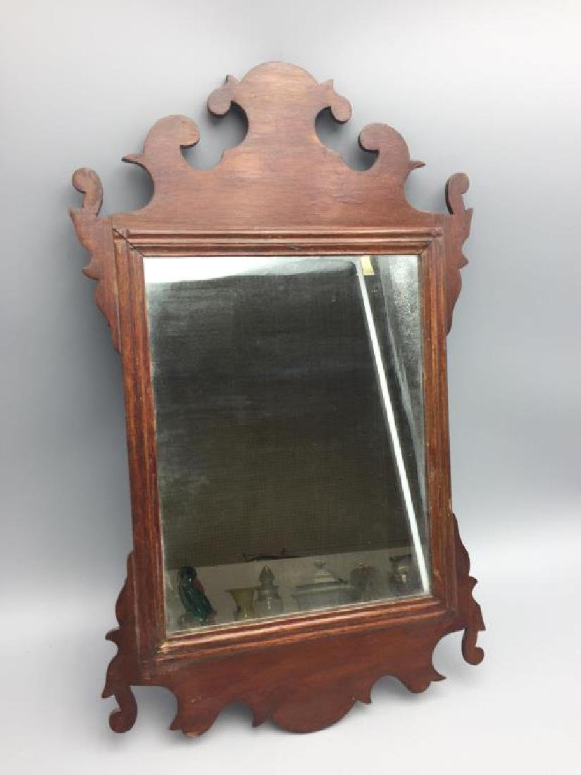 Small antique mirror in wood frame