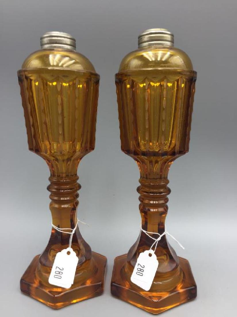 Pair early Amber glass oil lamps