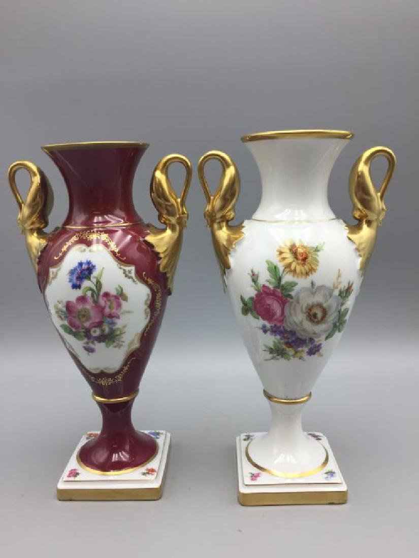Pair  hand painted  porcelain urns
