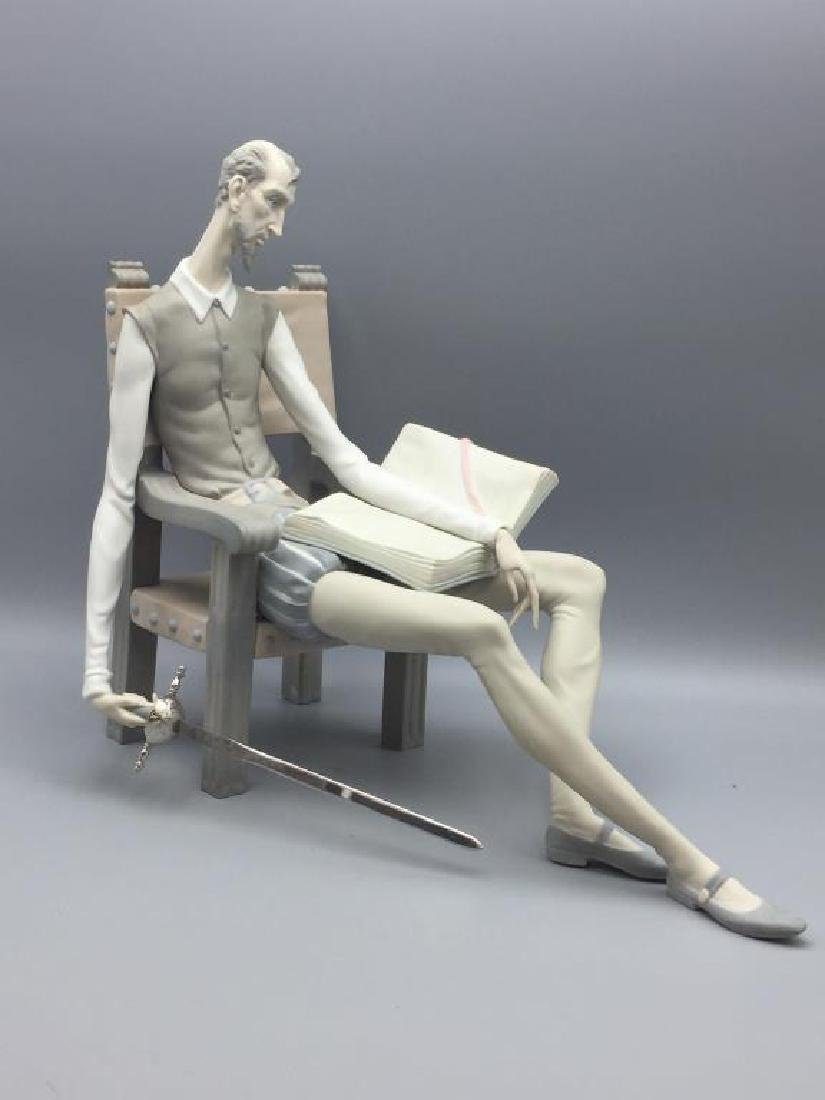 Lladro Don Quixote sitting in chair